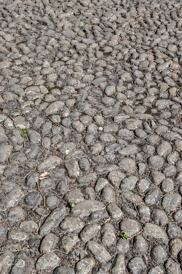Κυβόλινθοι Cobble επιφάνεια πεζοδρομίων πετρών στοκ φωτογραφία