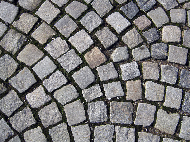 Cobble. Old street in the town stock images