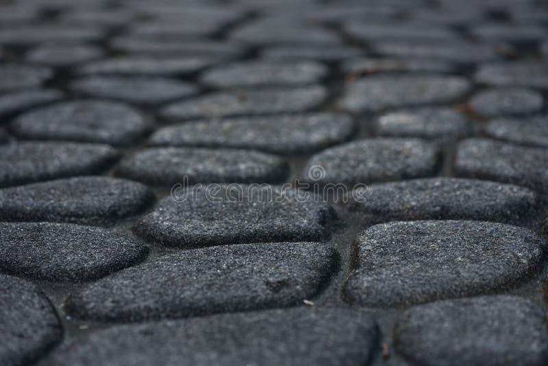 Cobble steenbestrating stock foto