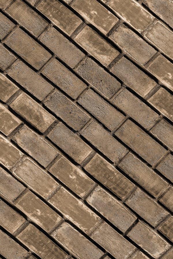 Cobble stone muruje wiele brązowych szarych, ukośnych, miejskich podstaw zdjęcie stock