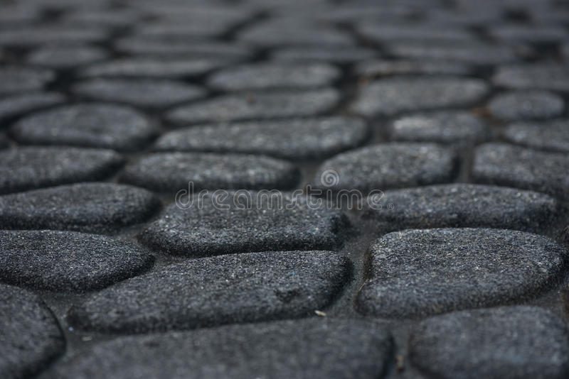 Cobble Stone Pavement. Using a low angle perspective stock photo