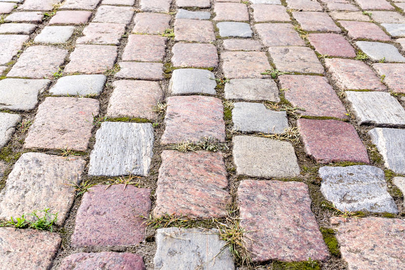 Cobbled block pavement stock images