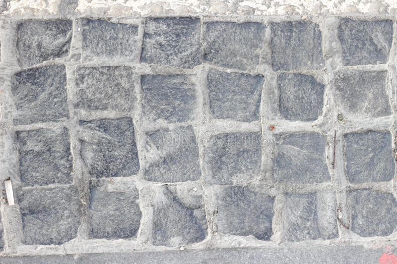 Cobbled pavement made of granite cubes stock images