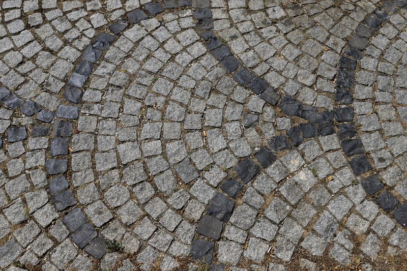 Cobbled road close-up; texture; background royalty free stock photography