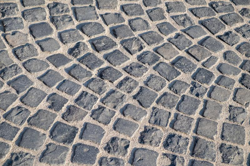 Cobbled stone pavement in grey colours royalty free stock photography