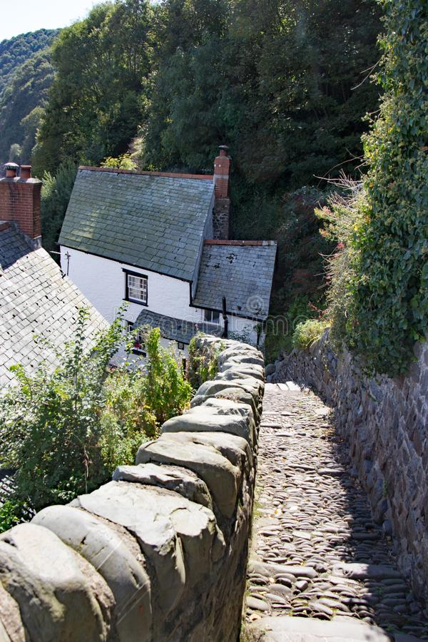 Cobbeled street in clovelly north devon uk. Cobbled street in Clovelly north devon uk with houses in background stock image
