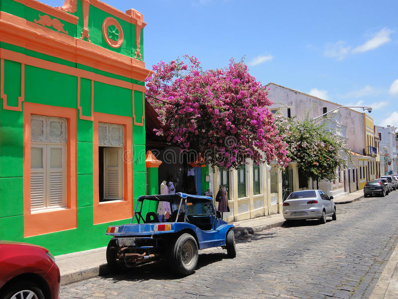 Cobbled street in historic town Olinda, Brazil. Old street in Brazilian city Olinda with colorful houses stock photos