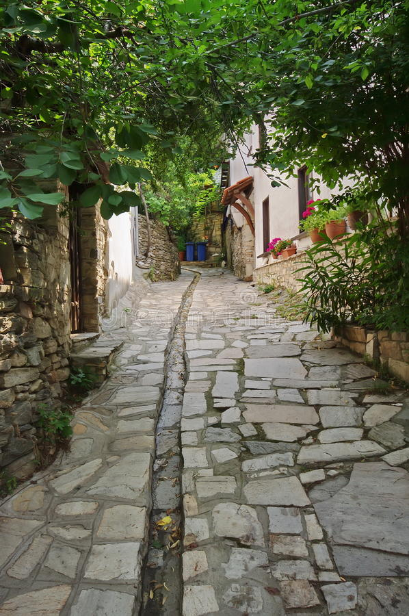 Cobbled street - Thassos Island, Greece. Cobbled street in Thassos Island, Greece royalty free stock photo