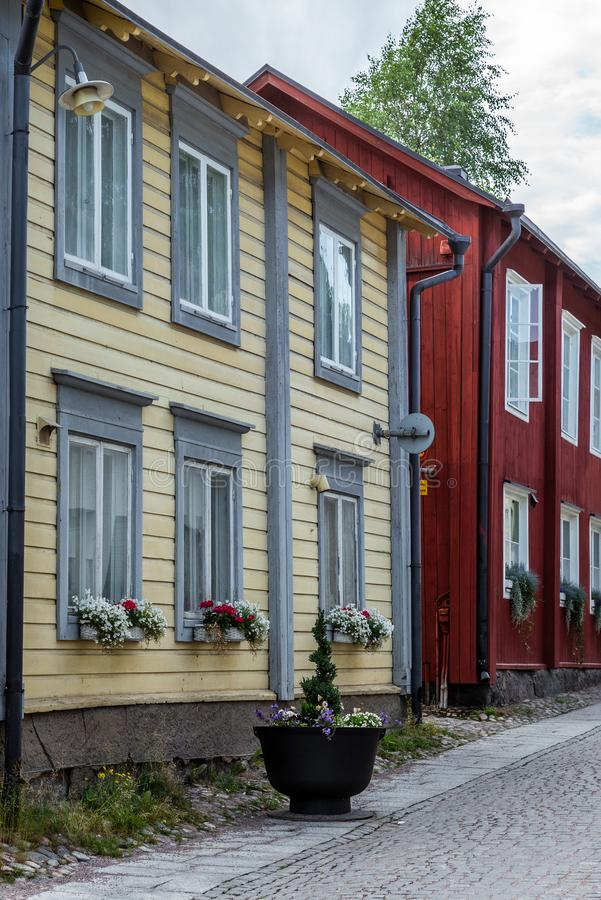 Cobbled streets and colorfully painted old wooden houses in Porvoo in Finland in a summer evening - 3. Cobbled streets and colorfully painted old wooden houses royalty free stock image