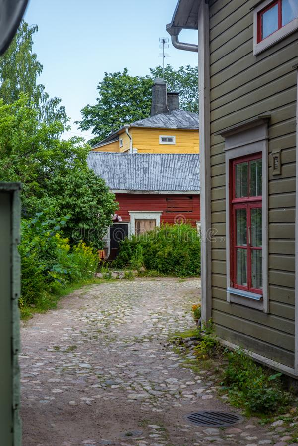Cobbled streets and colorfully painted old wooden houses in Porvoo in Finland in a summer evening - 7. Cobbled streets and colorfully painted old wooden houses stock photography