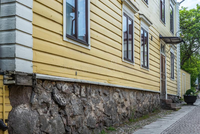 Cobbled streets and colorfully painted old wooden houses in Porvoo in Finland in a summer evening - 1. Cobbled streets and colorfully painted old wooden houses stock photo