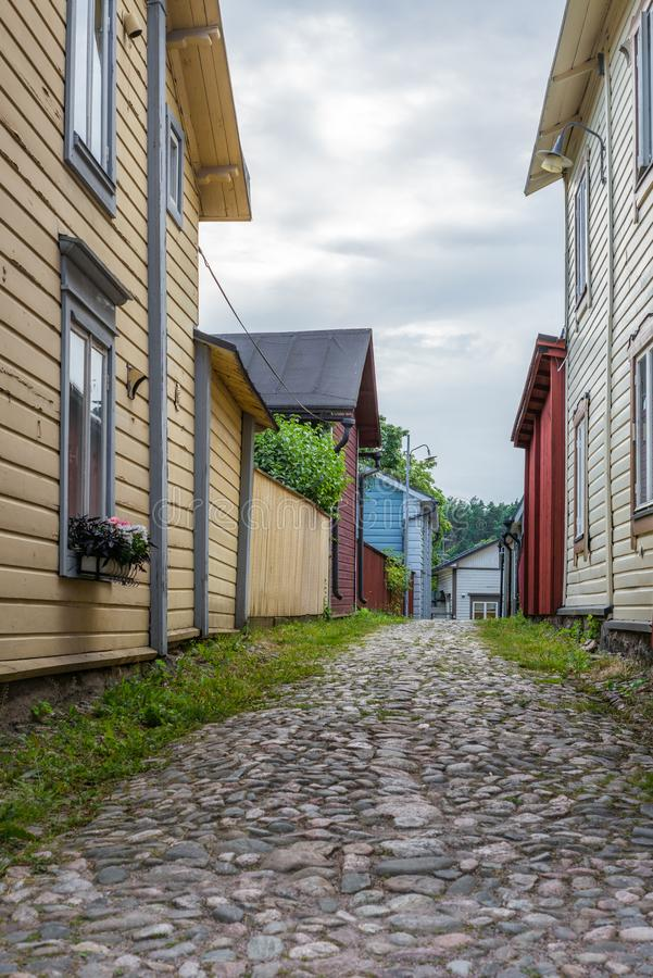 Cobbled streets and colorfully painted old wooden houses in Porvoo in Finland in a summer evening - 5. Cobbled streets and colorfully painted old wooden houses royalty free stock photos