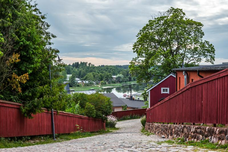 Cobbled streets and colorfully painted old wooden houses in Porvoo in Finland in a summer evening - 13. Cobbled streets and colorfully painted old wooden houses stock image