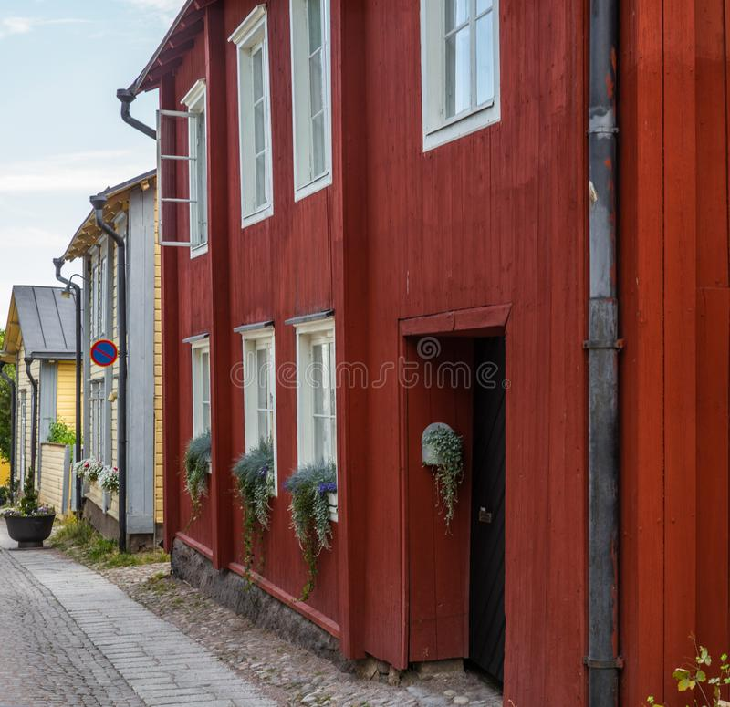 Cobbled streets and colorfully painted old wooden houses in Porvoo in Finland in a summer evening - 16. Cobbled streets and colorfully painted old wooden houses stock photography