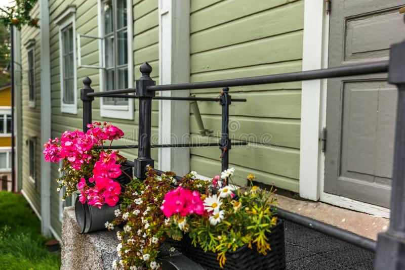 Cobbled streets and colorfully painted old wooden houses in Porvoo in Finland in a summer evening - 20. Cobbled streets and colorfully painted old wooden houses royalty free stock photography