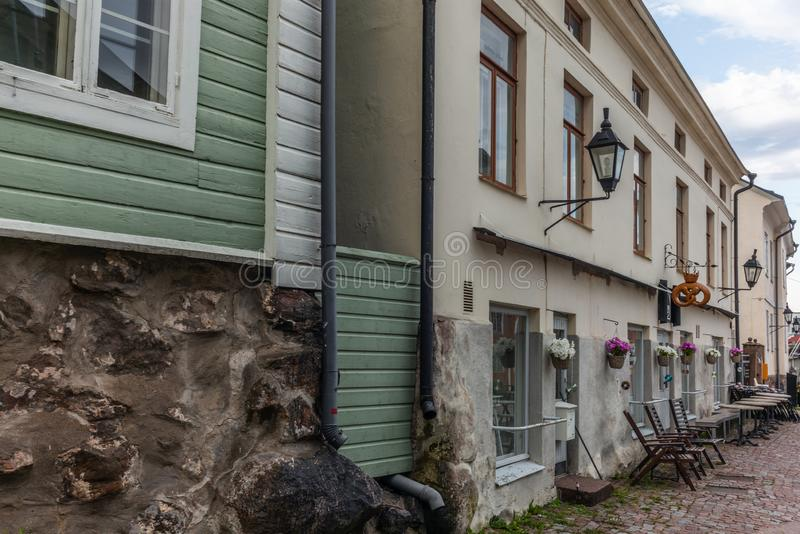 Cobbled streets and colorfully painted old wooden houses in Porvoo in Finland in a summer evening - 21. Cobbled streets and colorfully painted old wooden houses royalty free stock photo