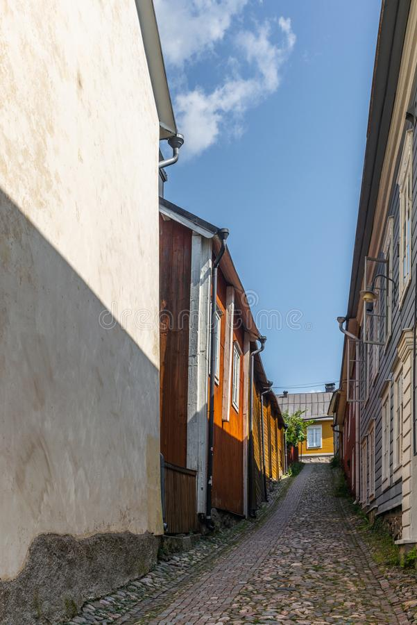 Cobbled streets and colorfully painted old wooden houses in Porvoo in Finland in a summer evening - 27. Cobbled streets and colorfully painted old wooden houses royalty free stock image