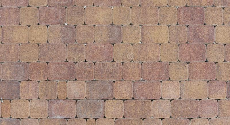 Cobbled surface with paving stones top view Natural stone pavement. royalty free stock images