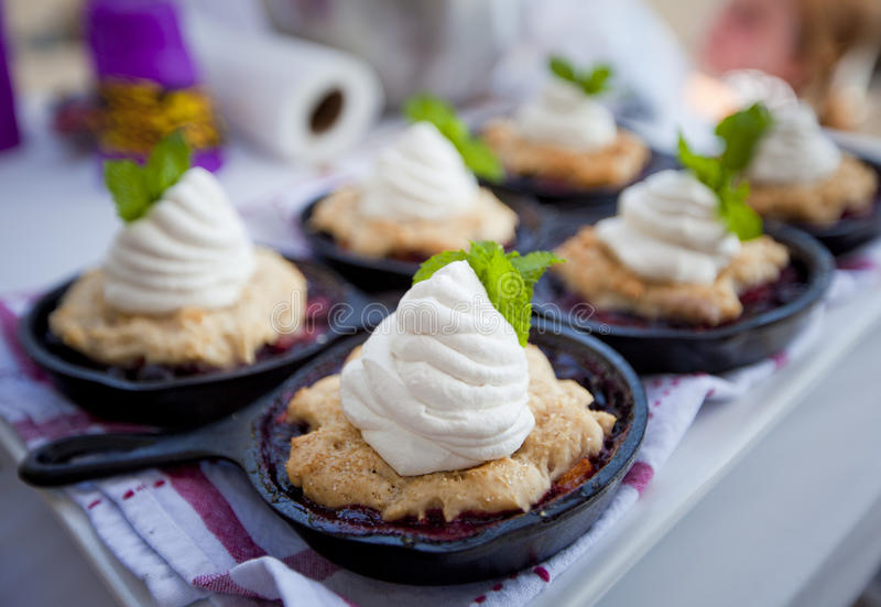 Cobbler. Fresh fruit cobbler in a cooking skillet royalty free stock photos