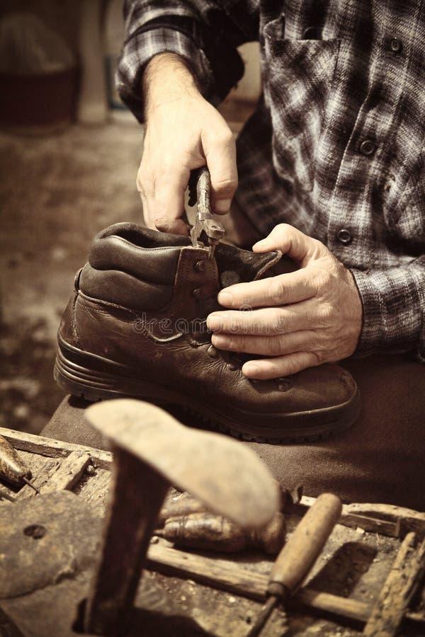Cobbler at work royalty free stock image
