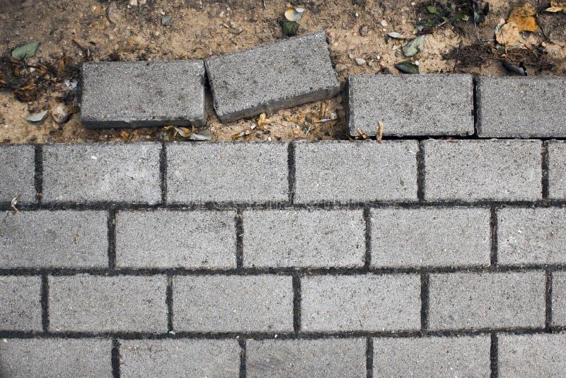 cobbles Teste padrão de pedra da estrada inacabado foto de stock