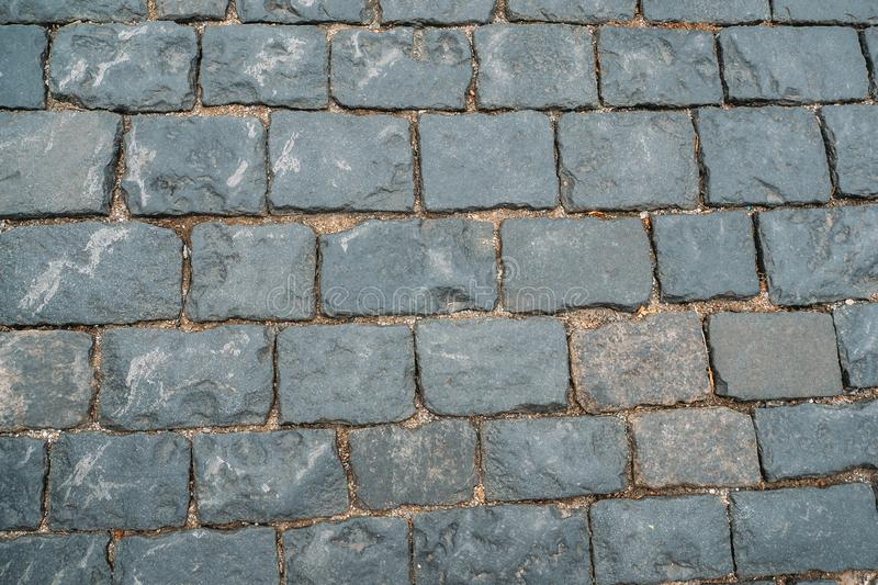 Cobbles texture background, old grunge stone blocks floor surface stock images