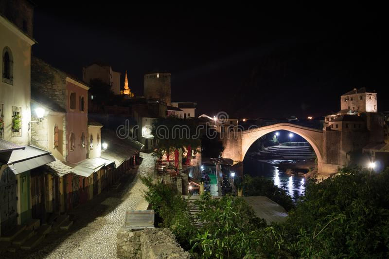 Cobblestone Alley with Old Bridge Stari Most in Mostar at Night. Bosnia and Herzegovina royalty free stock photography