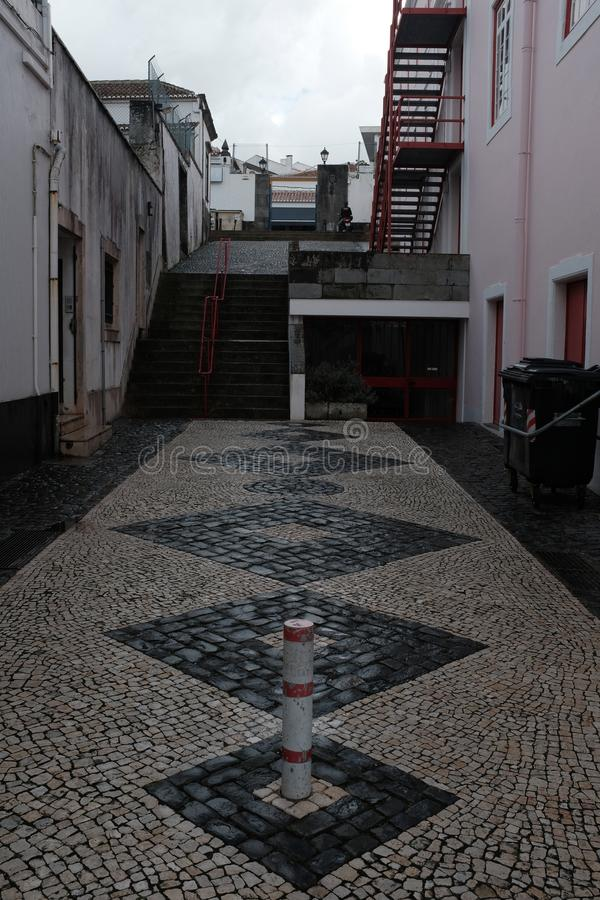 Cobblestone Alleyway with Diamonds in Portugal. Details of a cobblestone alleyway in the Portuguese city Angro Do Heroismo, on Terceira Island, in the Azores stock images