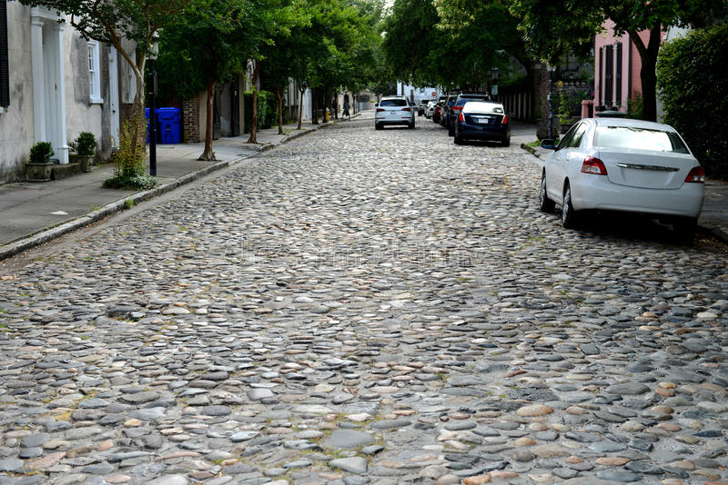 Cobblestone Alleyway. A quiet cobblestone alleyway at the French Quarter of Downtown Charleston, South Carolina, USA royalty free stock photos