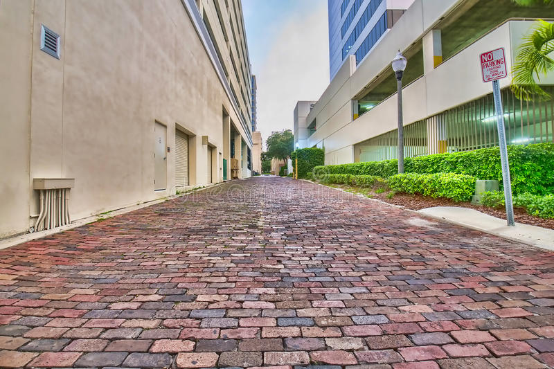 Cobblestone Back Alley Road. Red Cobblestone back alley road between buildings royalty free stock photos