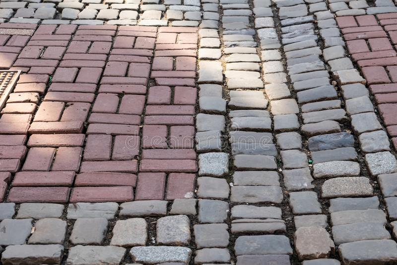 Modern day cobblestone background in the sunlight royalty free stock photography