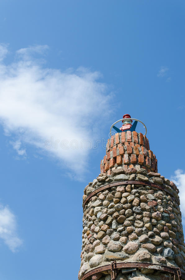 Cobblestone lighthouse tower blue sky background royalty free stock images
