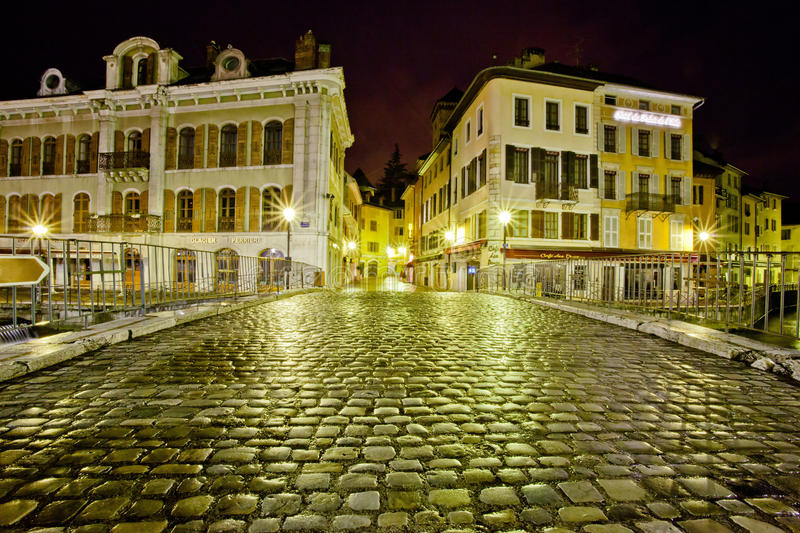Cobblestone Palais de L'isle bridge, Annecy, Franc. Annecy, France. The cobblestone Palais de L'isle bridge of Annecy's old town. Picture was taken on January stock image
