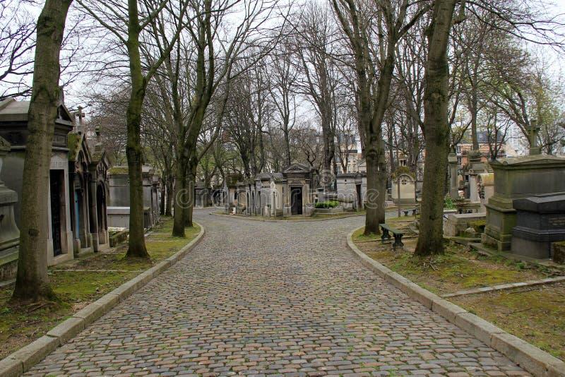 Cobblestone pathway through famous landmark, Pere Lachaise Cemetery,Paris,2016 royalty free stock image
