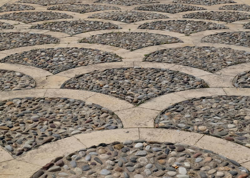 Cobblestone pattern. Scallop pattern cobble stone street, abstract background royalty free stock photos