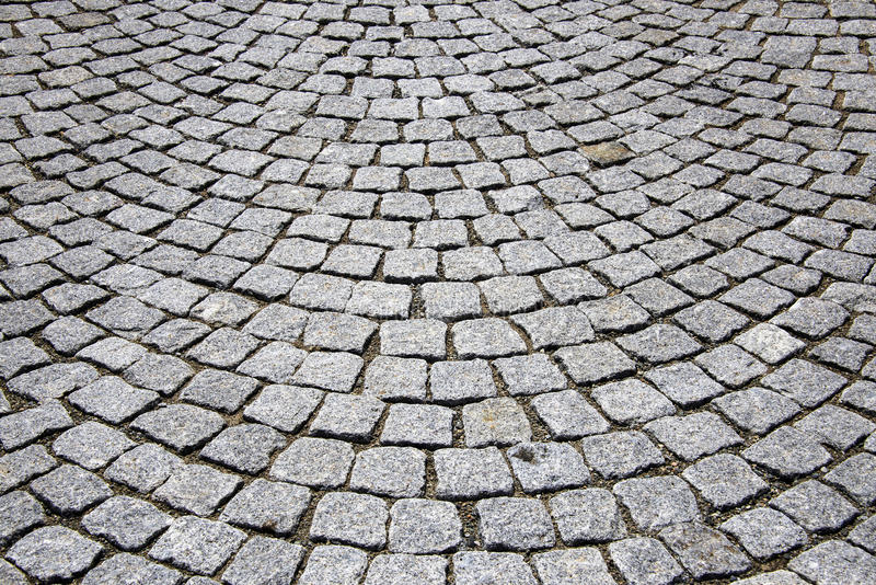 Cobblestone pavement. Abstract background of cobblestone pavement royalty free stock photography