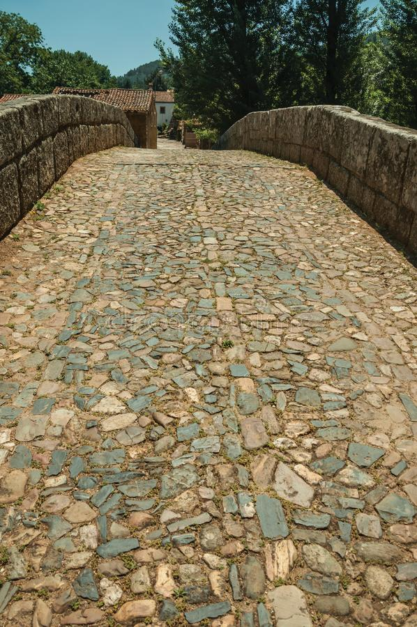 Cobblestone pavement over an old Roman bridge in Portagem. Cobblestone pavement and breastwork over an old Roman bridge still in use over the Sever River among stock images