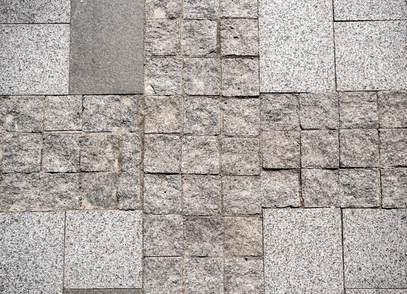 Cobblestone pavement with pattern. In the city royalty free stock photos