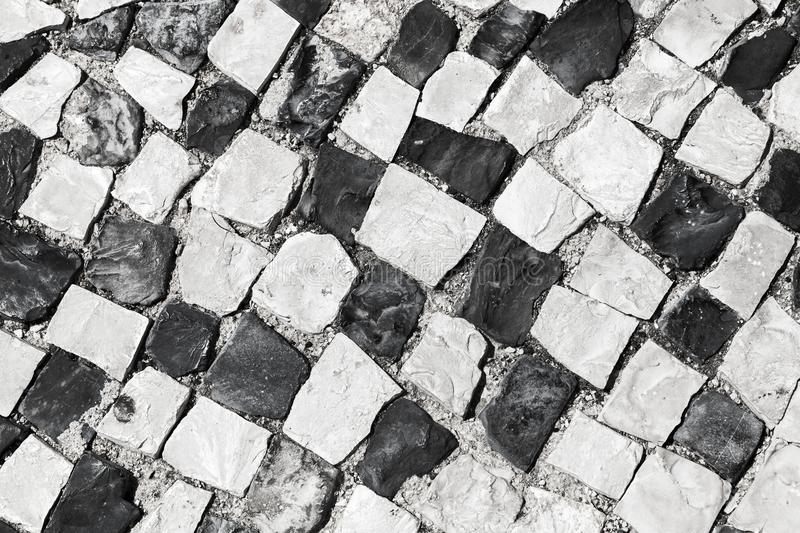 Cobblestone pavement pattern, Lisbon, Portugal royalty free stock photography