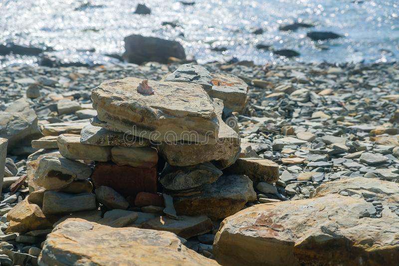 Cobblestone and pebbles and balance stones. Seashell on the stones. royalty free stock images