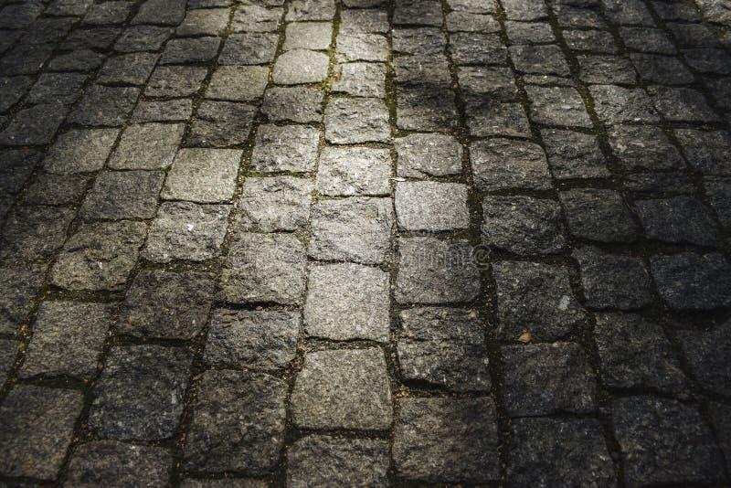 Cobblestone road texture stock images