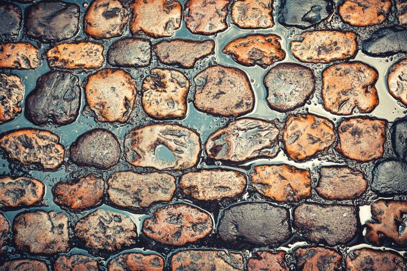 Cobblestone. Road texture after rain royalty free stock photos