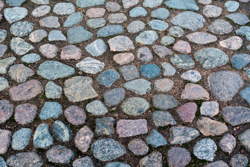 Cobblestone roadway texture. Or background stock images
