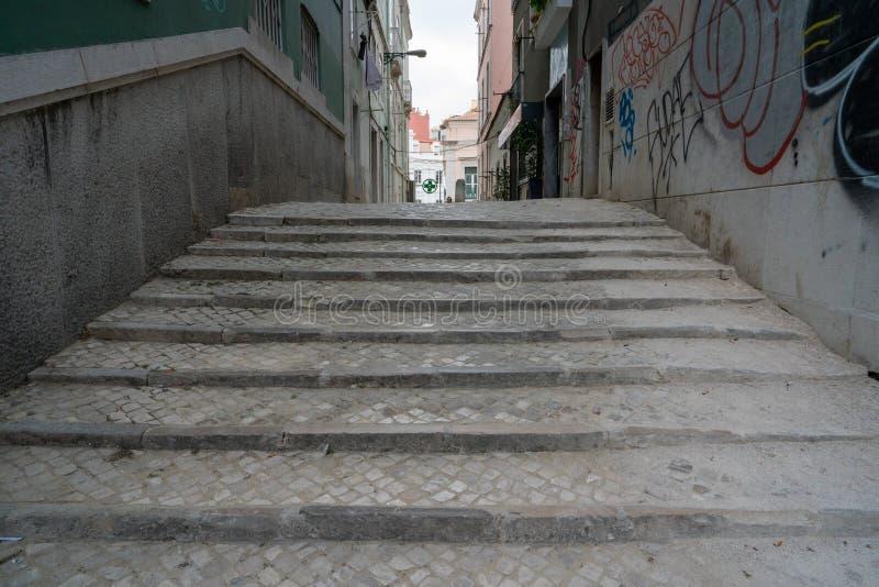 Cobblestone steps leading into an empty alleyway in daytime. Cobblestone steps leading into an empty alleyway in the daytime royalty free stock photo