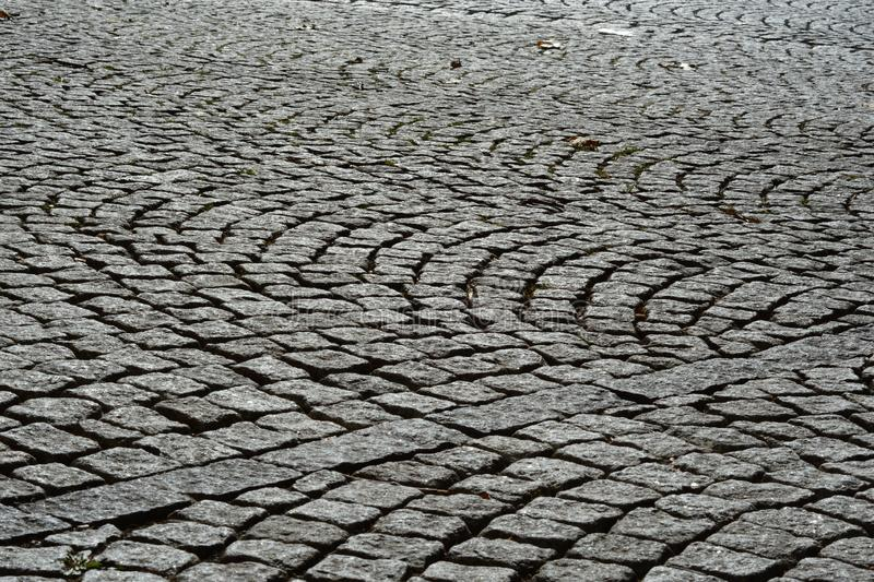 Cobblestone street abstract wallpaper background. Gray royalty free stock image