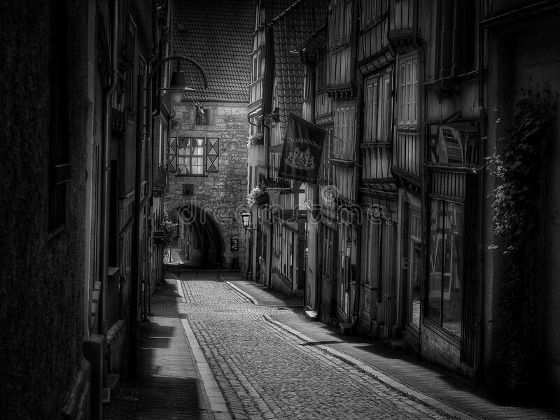 Cobblestone street in black and white royalty free stock photos