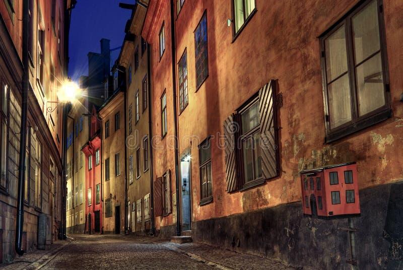 Cobblestone street at night. royalty free stock image