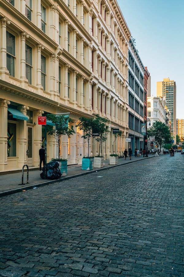 A cobblestone street in SoHo, Manhattan, New York City royalty free stock image