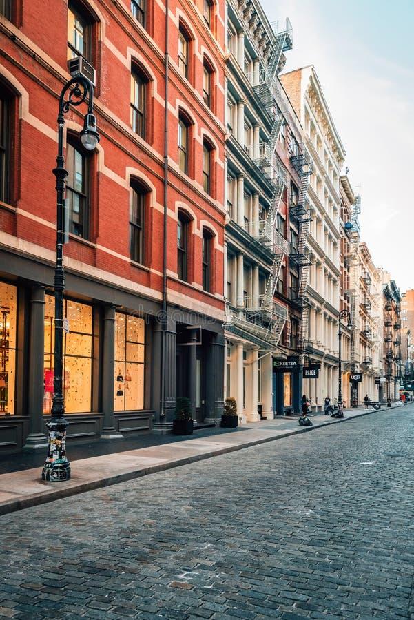 A cobblestone street in SoHo, Manhattan, New York City royalty free stock images