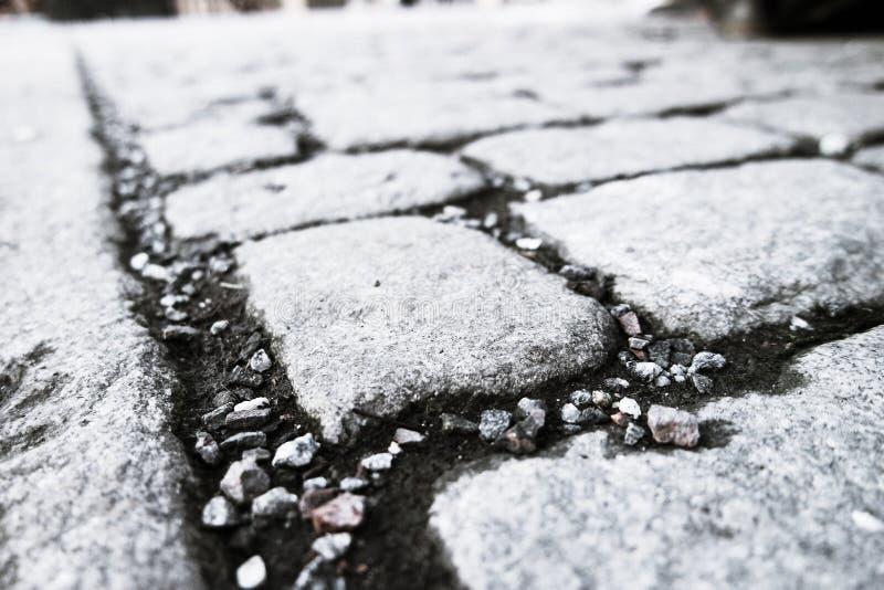 Cobblestone walk path black color. In the city royalty free stock image